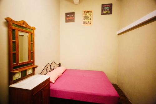 A bed or beds in a room at Backpacker Cozy Corner Guesthouse (SG Clean)