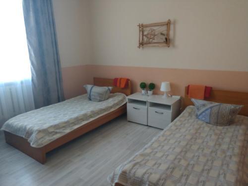 Кровать или кровати в номере Zolotoi Skorpion