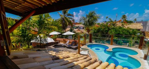 A view of the pool at Sobrado da Vila Hotel or nearby