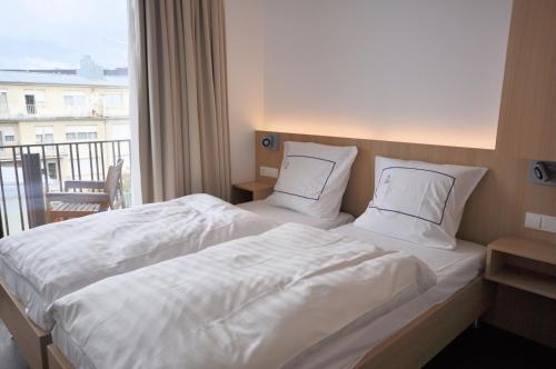 Ein Bett oder Betten in einem Zimmer der Unterkunft Apart2stay