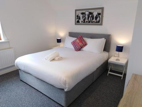 A bed or beds in a room at Burren Court
