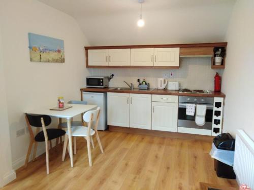 A kitchen or kitchenette at Burren Court