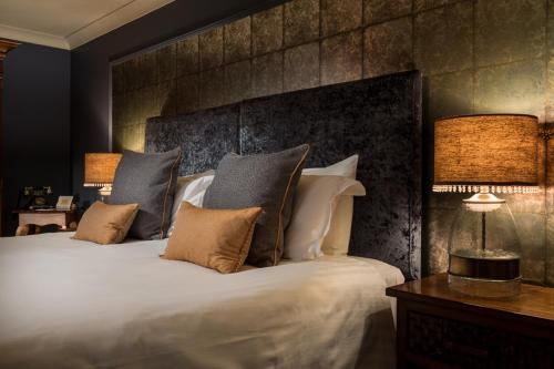 A bed or beds in a room at Talland Bay Hotel
