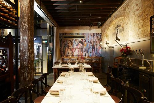A restaurant or other place to eat at Ovolo 1888 Darling Harbour