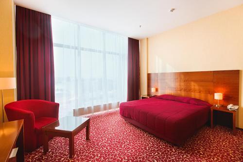 Кровать или кровати в номере Гранд отель Казань