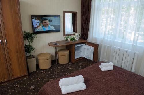Телевизор и/или развлекательный центр в Отель Гранат