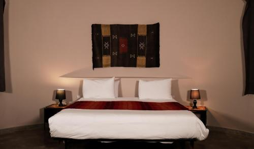 A bed or beds in a room at Villa Agapanthe