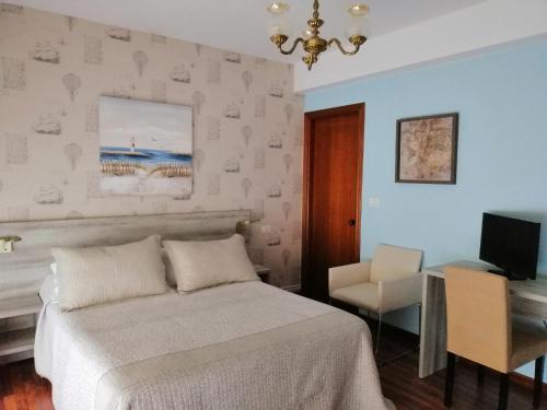 Cama o camas de una habitación en Hospedaje A Goleta