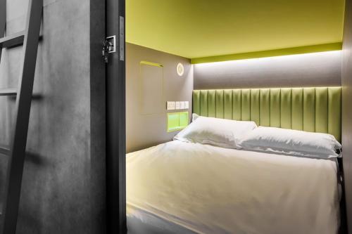 Ein Bett oder Betten in einem Zimmer der Unterkunft Circular House