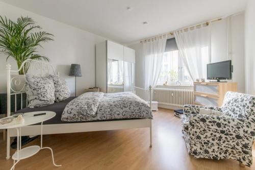 TV a/nebo společenská místnost v ubytování Privatapartment Südstadt (6301)