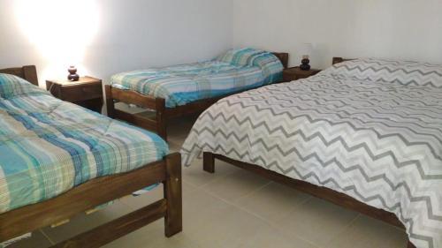 Una cama o camas en una habitación de Finca Los Arrieros - Cabañas