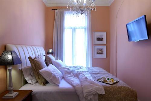 Ένα ή περισσότερα κρεβάτια σε δωμάτιο στο Sweet Home Hotel