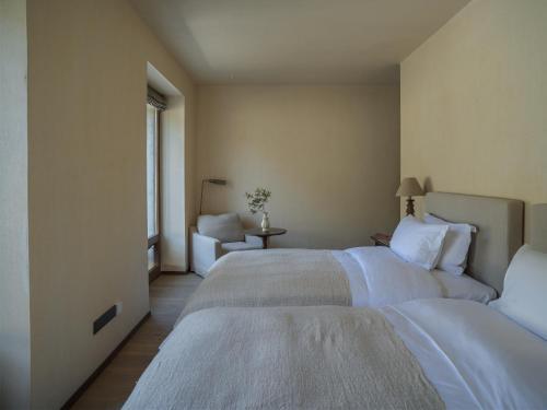 Krevet ili kreveti u jedinici u objektu Sunyata Hotel. Deqin Meili