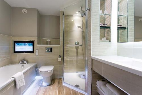 A bathroom at Cottons Hotel and Spa
