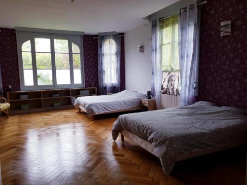 Un ou plusieurs lits dans un hébergement de l'établissement Domaine de L'Arche de René