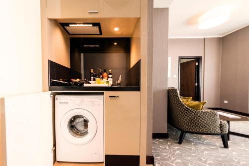 A kitchen or kitchenette at Hawthorn Suites by Wyndham Abu Dhabi City Center
