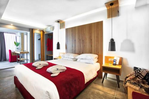 A bed or beds in a room at Capsis Astoria Heraklion