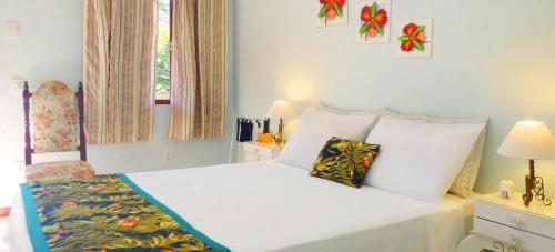 A bed or beds in a room at Pousada Horizonte dos Borbas