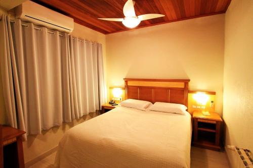 A bed or beds in a room at Pousada Gramado