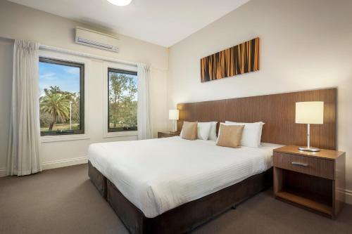 A bed or beds in a room at Quest Ipswich