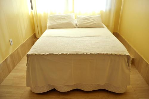 A bed or beds in a room at Faixa Hotel