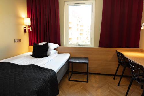 A bed or beds in a room at Best Western Arena Hotel Gothenburg