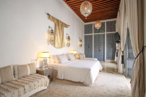 A bed or beds in a room at Riad Adore