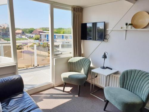 A seating area at Apartment De Zeemeermin