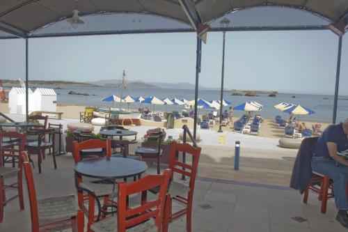 A restaurant or other place to eat at Danaos Hotel