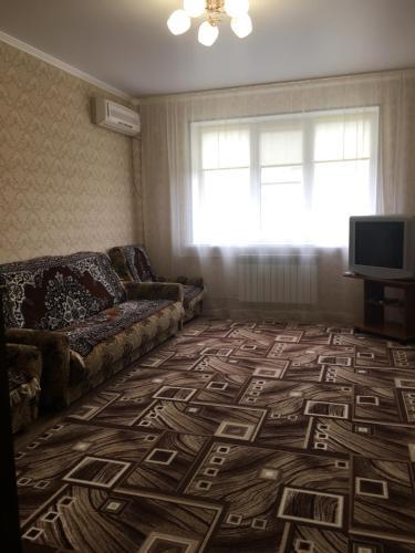 A bed or beds in a room at 2-х комнатная квартира на Полевой