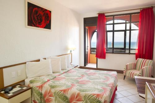 A bed or beds in a room at Sol Bahia Sleep