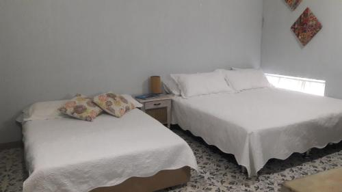 A bed or beds in a room at Casa Anita