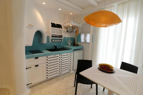 A kitchen or kitchenette at Naxos Cave Suites