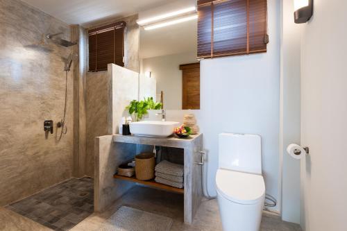 Ein Badezimmer in der Unterkunft Cape Shark Villas