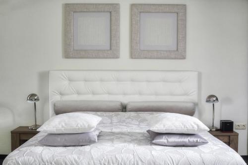 Een bed of bedden in een kamer bij Hotel Kasteel Doenrade
