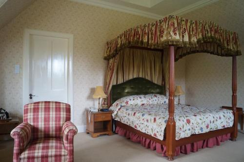 A bed or beds in a room at Glengarry Castle Hotel