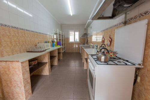 A kitchen or kitchenette at Guest house Solnechnaya 7