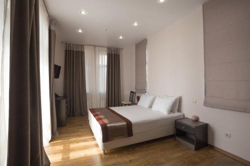 Кровать или кровати в номере Отель Афина