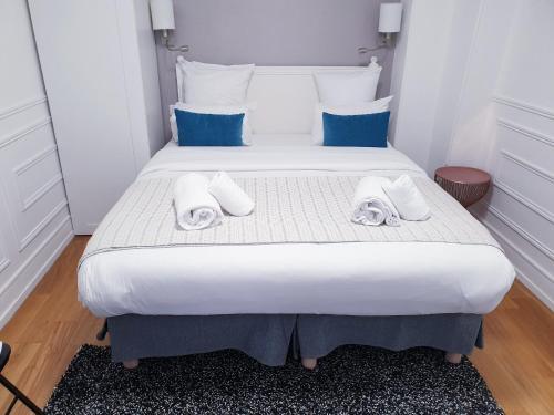 Een bed of bedden in een kamer bij Apartment Quartier Latin - Monge