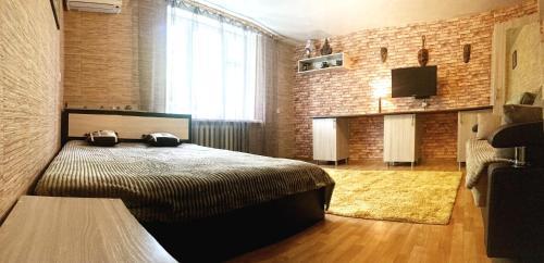 Кровать или кровати в номере Тихий дворик