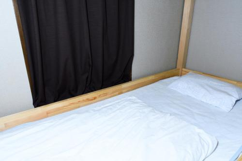 A bed or beds in a room at Hostel Hana An