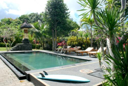 The swimming pool at or near Uluwatu Made Guesthouse