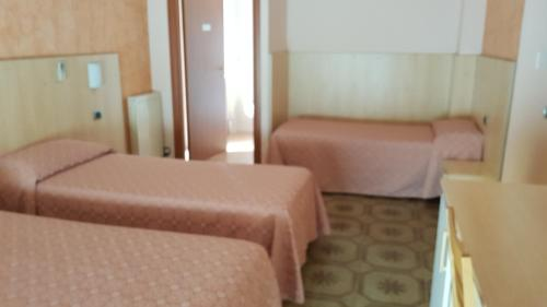 A bed or beds in a room at La Collina