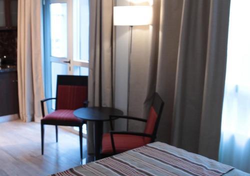Cama ou camas em um quarto em Hotel UOM Buenos Aires
