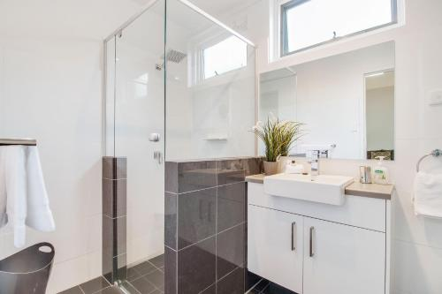 A bathroom at Adelaide Dress Circle Apartments - Sussex Street