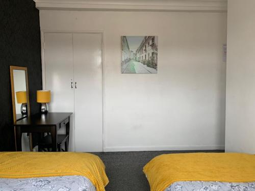 A bed or beds in a room at London budget Maisonette