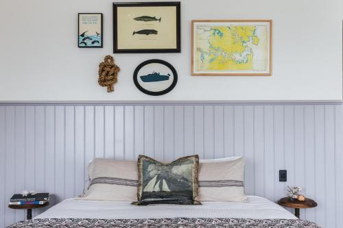A bed or beds in a room at Watsons Bay Boutique Hotel