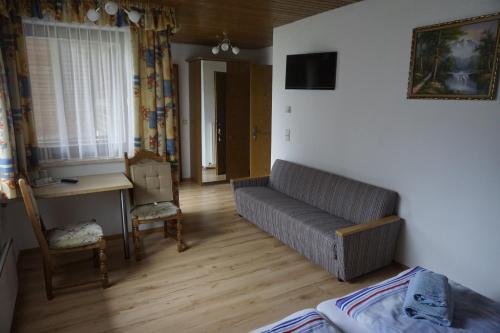 Ein Sitzbereich in der Unterkunft Pension-Ferienwohnung Rotar