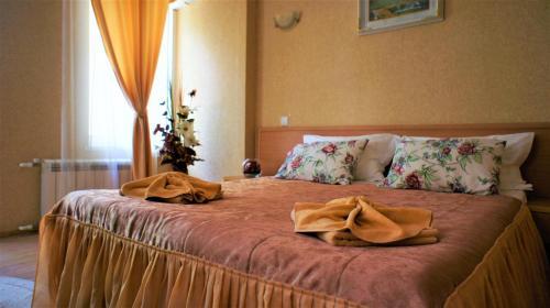 Кровать или кровати в номере Отель ПОЛИНА