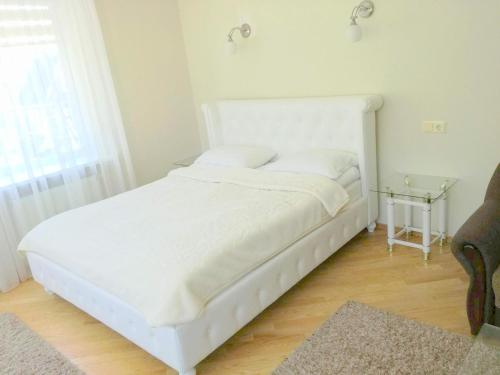A bed or beds in a room at Agava